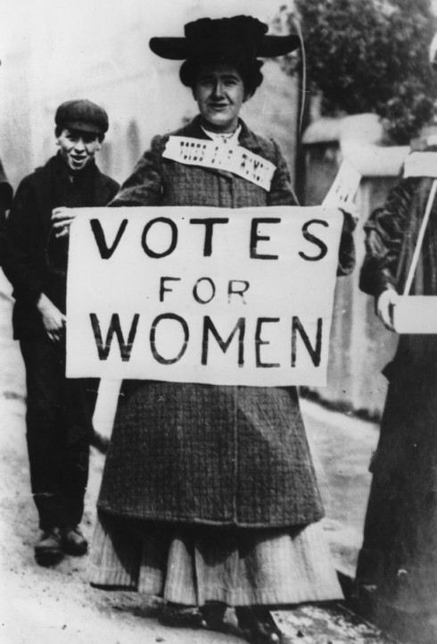 3_Miss-Billington-carries-a-banner-enscribed-with-the-suffragette-slogan-Votes-For-Women